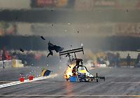 Feb 9, 2014; Pomona, CA, USA; NHRA top fuel dragster driver Sidnei Frigo blows an engine and tire during qualifying for the Winternationals at Auto Club Raceway at Pomona. Mandatory Credit: Mark J. Rebilas-