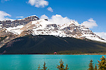 The Icefields Parkway stretches 230 km (142 miles) between Lake Louise and the town of Jasper and travels through the heart of the Canadian Rockies.  The highway parallels the Main Ranges of the Canadian Rockies within Banff and Jasper National Parks.  The peaks of the mountains visible from the highway can reach an altitude of 3300 meters (11,000 feet).  Many glacially fed streams and lakes can be seen and visited along the way.  Pictured here is Bow Lake.  It's possible to stay here at Num-Ti-Jah Lodge, or just stop in for the views of the beautiful lake and visit their souvenir shop or grab a bite to eat and drink.
