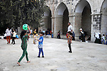 Palestinian children play at Al-Aqsa mosque compound in the old city of Jerusalem during the fasting month of Ramadan on July 31, 2012. Photo by Saeed Qaq