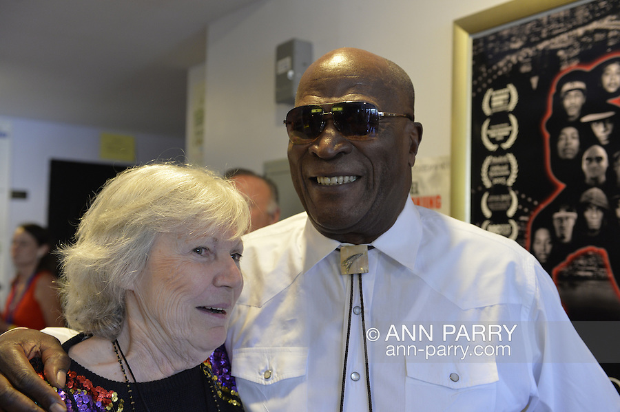 Bellmore, New York, USA. July 16, 2015. Actress MARILYN CHRIS and actor JOHN AMOS talk at the 18th Annual LIIFE Awards Ceremony, at Bellmore Movies. Chris was long-time character Wanda Web Wolek on the TV soap opera One Life to Live, which Amos played Detective Johnson in the late 1980s. Chris presented the Documentary Award at the Long Island International Film Expo. Amos was an LIFTF Lifetime Creative Achievement Honoree for his work in films such as ROOTS, and DIE HARD 2, and COMING TO AMERICA.