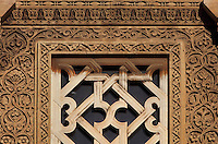 Architectural detail of the Puerta de San Ildefonso, built under Al-Hakam II in the 10th century, one of the West facade entrances to the Cathedral-Great Mosque of Cordoba, on the Calle Torrijos in Cordoba, Andalusia, Southern Spain. This detail shows the intricately carved vegetal patterns and a knotted lattice over a window. The first church built here by the Visigoths in the 7th century was split in half by the Moors, becoming half church, half mosque. In 784, the Great Mosque of Cordoba was begun in its place and developed over 200 years, but in 1236 it was converted into a catholic church, with a Renaissance cathedral nave built in the 16th century. The historic centre of Cordoba is listed as a UNESCO World Heritage Site. Picture by Manuel Cohen