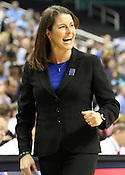 Duke Coach Joanne P. McCallie encourages her team from the sideline. This was the Championship game of the 2011 ACC Tournament in Greensboro on March 6, 2011. Duke beat UNC 81-66. (Photo by Al Drago)