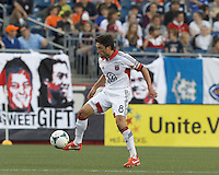 D.C. United midfielder John Thorrington (8) controls the ball at midfield.  In a Major League Soccer (MLS) match, the New England Revolution (blue) tied D.C. United (white), 0-0, at Gillette Stadium on June 8, 2013.