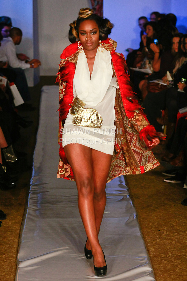 Model walks runway in an outfit from the Naked Roots Fall 2012 collection, by Eunika Simmons at Plitzs Fashion Week Fall 2012, during New York Fashion Week Fall 2012.