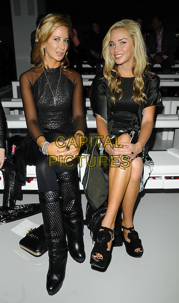 Lady Victoria Hervey &amp; Noelle Reno<br /> The London Fashion Week s/s 2014 Maria Grachvogel catwalk show, BFC Showspace, Somerset House, The Strand, London, England.<br /> September 17th, 2013<br /> full length black dress white print silk satin sitting boots top sheer<br /> CAP/CAN<br /> &copy;Can Nguyen/Capital Pictures