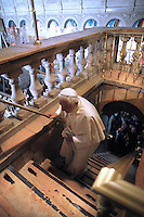 Pope Benedict XVI prays at the sepulchre,the traditional site where Jesus is believed to be buried, inside the the Church of the Holy Sepulchre, in Jerusalem's Old City, Friday, May 15, 2009.