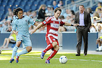 Zach Loyd (17) FC Dallas defender goes past Sporting KC midfielder Roger Espinoza.. Sporting KC defeated FC Dallas 2-1 at LIVESTRONG Sporting Park, Kansas City, Kansas.