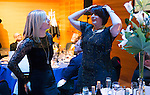 St Johnstone FC Scottish Cup Celebration Dinner at Perth Concert Hall...01.02.15<br /> Tommy Wright's wife Anne (right) and Callum Davidson's wife Laura play a game of Heads and Tails which involved guessing who scored and who missed penalties<br /> Picture by Graeme Hart.<br /> Copyright Perthshire Picture Agency<br /> Tel: 01738 623350  Mobile: 07990 594431