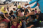 Ice distribution to people in Anwald refugee camp, Northern Iraq