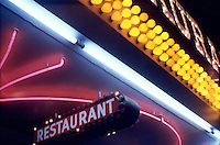 Photo of a Nighttime Restaurant Sign in lights. This is a Brownie Box Camera Photo taken Downtown Las Vegas in the 1980's.