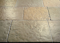 Solid Limestone Tiles with hand-cut edge, partially bush hammered surface and consumed natural undulated, time worn finish. Shown in a highly variegated Beige. Please call for color and size availability.