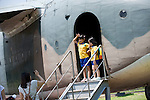 Korean school children pose for a photo in the doorway of a military plane on display at the National War Museum in Seoul, South Korea on 23 June, 2010..