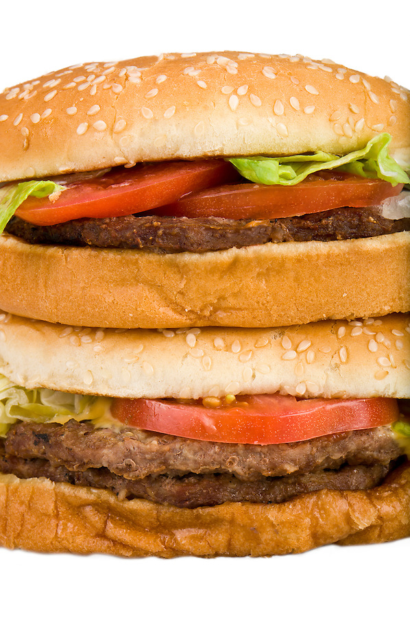 Close up of a stack of hamburgers isolated white.
