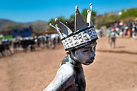 "A Cora Indian boy, wearing a paper crown, dances during the sacred ritual celebration of Semana Santa (Holy Week) in Jesús María, Nayarit, Mexico, 21 April 2011. The annual week-long Easter festivity (called ""La Judea""), performed in the rugged mountain country of Sierra del Nayar, merges indigenous tradition (agricultural cycle and the regeneration of life worshipping) and animistic beliefs with the Christian dogma. Each year in the spring, the Cora villages are taken over by hundreds of wildly running men. Painted all over their semi-naked bodies, fighting ritual battles with wooden swords and dancing crazily, they perform demons (the evil) that metaphorically chase Jesus Christ, kill him, but finally fail due to his resurrection. La Judea, the Holy Week sacred spectacle, represents the most truthful expression of the Coras' culture, religiosity and identity."