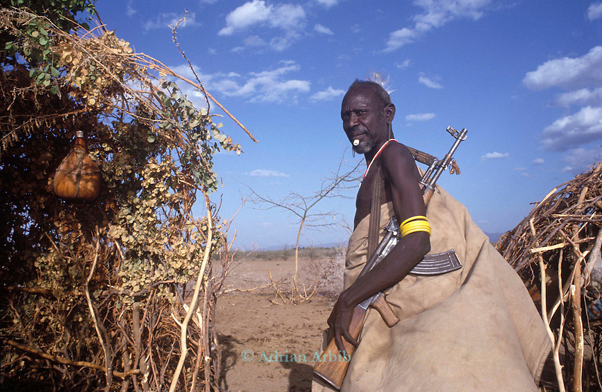 A  Turkana nomad  protects his  family & herd of  goats with  an AK47.  With the proliferation of  automatiic  weapons in the region ( on the border with South Sudan)  violent conflict has increased dramatically)...Nothern Kenya.