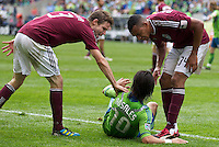 Colorado Rapids defender Drew Moor, left, and defender Tyrone Marshall accuse Seattle Sounders FC forward Mauro Rosales of diving during play at CenturyLink Field in Seattle Saturday July 16, 2011. The Sounders won the game 4-3.