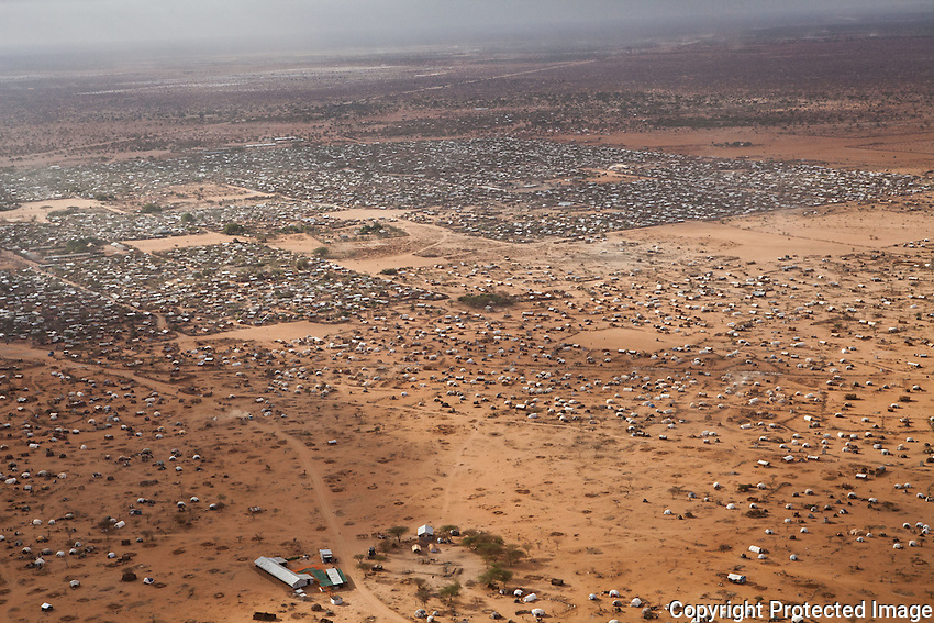 Aerial view of Dagahaley outskirts in the foreground, Dagahaley camp and the Ifo extension in the distant background. With nearly 500,000 refugees dadaab is the largest refugee camp in the world. Oct 2011. Brendan Bannon/IOM/UNHCR