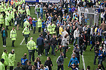 Sheffield Wednesday fans being ushered off the pitch by stewards at Hillsborough after the final whistle of the crucial last-day relegation match against Crystal Palace. The match ended in a 2-2 draw which meant Wednesday were relegated to League 1. Crystal Palace remained in the Championship despite having been deducted 10 points for entering administration during the season.