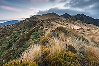 Sunrise over mountains and Mount Brown Hut, West Coast, South Westland, New Zealand