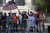 NEW YORK, NY - May 01:  A group of President Trump supporters confront people attending to the May Day Strike for workers rights at Foley Square. Labor unions and civil rights groups staged May Day rallies in several U.S. cities on Monday to denounce President Donald Trump's get-tough policy on immigrationIn New York City on May 01, 2017. Photo by VIEWpress/Maite H. Mateo.