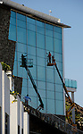 Me and my shadow,cleaning windows of large hotel on a cherry picker, Mogan, Gran Canaria, Spain.