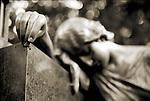 A mournful statue in a cemetery