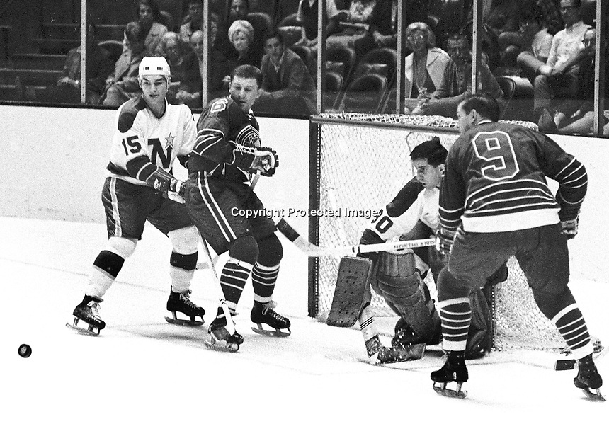 Seals vs. North Stars, Wally Boyer and Bill Hicke, .Andre Boudrian and goalie Cesare Maniago..1967 photo/Ron Riesterer