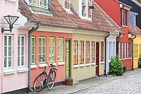Overstraede cobbled street with painted houses and cobblestone  in Odense on Funen Island, Denmark