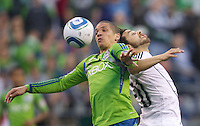 Seattle Sounders FC midfielder Osvaldo Alonso  beats Vancouver Whitecaps FC  defender Davide Chiumiento during play at Qwest Field in Seattle Saturday June 11, 2011. The game ended in a 2-2 draw.