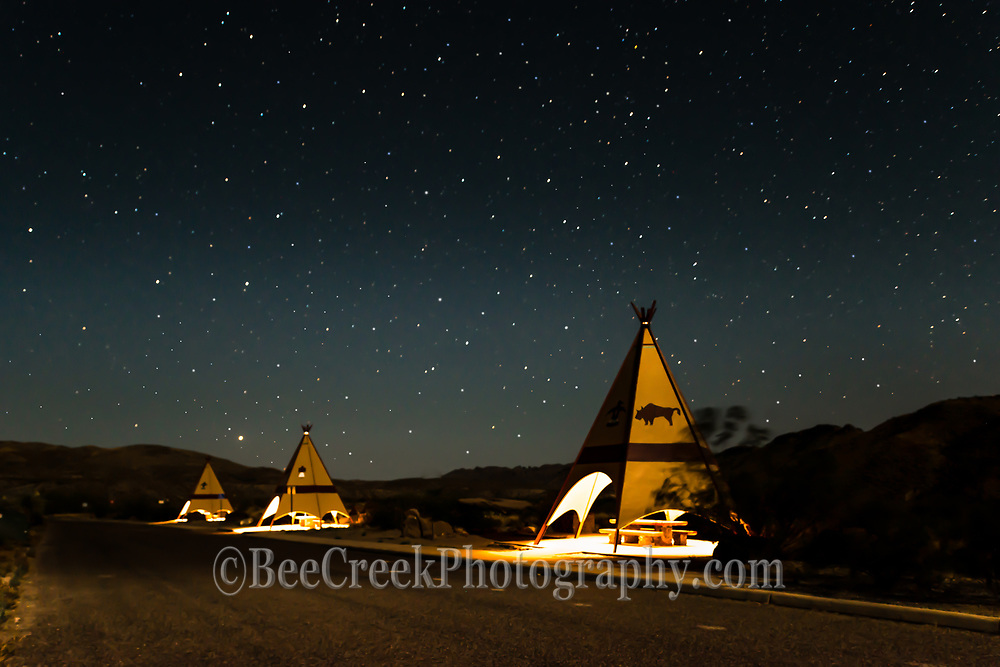We couldn't help but take this image with the stars over the teepees in the picnic area of Big Bend State Park.  To get more than a silouette landscape we decided to light the teepees and then light paint to help bring them out with these wonderful stars in the sky.  This image will print slightly darker but you can still see everything.