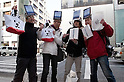 March 16, 2012, Tokyo, Japan - Satisfied buyers have bought the new iPad, right side Apple store buyers and left side Softbank store buyers in Ginza..Fans lined up overnight outside the Apple store in Ginza, to buy the new iPad. Japan was one of the first countries where Apple fans could get their hands on the new iPad.