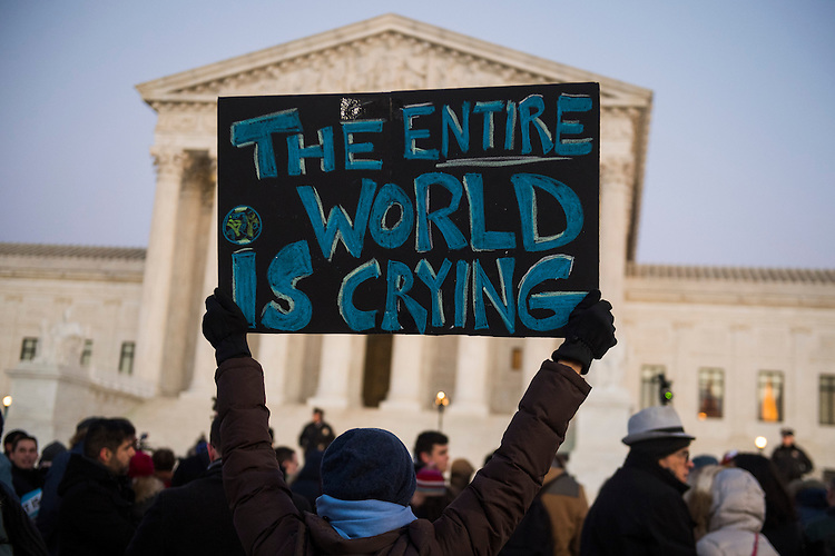 UNITED STATES - JANUARY 30: Protesters gather in front of the Supreme Court to voice opposition to President Trump's executive order barring immigrants from certain countries entry into the U.S., January 30, 2017. (Photo By Tom Williams/CQ Roll Call)