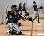 GLENDALE, AZ - FEBRUARY 24:  Tyler Flowers #17 of Chicago White Sox practices with other catchers during a spring training workout on February 24, 2010 at the White Sox training facility at Camelback Ranch in Glendale, Arizona. (Photo by Ron Vesely)