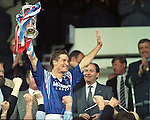 Rangers Captain Richard Gough lifts the Scottish Cup at Hampden in 1996 and salutes the fans over in section J..Scottish Secretary Michael Forsyth and David Murray look suitably impressed