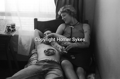 Earls Court, London. 1977<br /> Away Without Official Leave and on the run, an army deserter in his bedsit, enjoys a quite smoke and a tinny or two, and contemplates life with his girl friend.