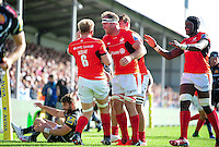 Saracens forwards congratulate Jackson Wray on his second half try. Aviva Premiership match, between Exeter Chiefs and Saracens on September 11, 2016 at Sandy Park in Exeter, England. Photo by: Patrick Khachfe / JMP