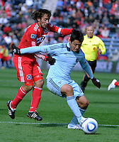 Sporting KC defender Roger Espinoza (15) shields the ball from Chicago Fire forward Gaston Puerari (18).  The Chicago Fire defeated Sporting KC 3-2 at Toyota Park in Bridgeview, IL on March 27, 2011.