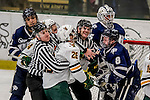 10 February 2017: University of Vermont Catamount Defenseman Trey Phillips, a Junior from Okotoks, Alberta, gets into a third period scuffle with University of New Hampshire Wildcat Forward Jamie Hill, a Senior from Glassboro, NJ, at Gutterson Fieldhouse in Burlington, Vermont. The Catamounts fell to the Wildcats 4-2 in the first game of their 2-game Hockey East Series. Mandatory Credit: Ed Wolfstein Photo *** RAW (NEF) Image File Available ***