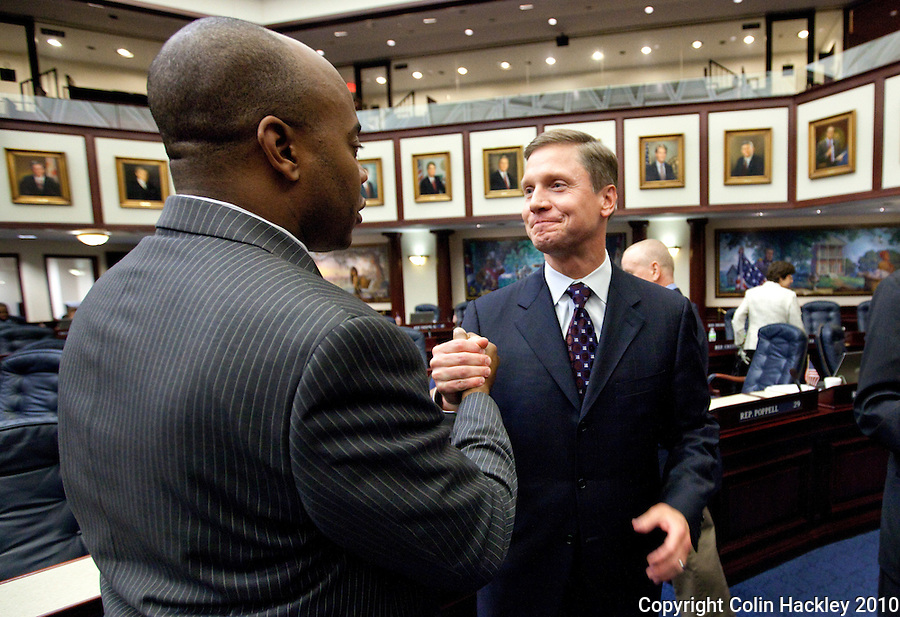 TALLAHASSEE, FLA. 4/30/10-CANNON 43010 CH04-Incoming House Speaker Dean Cannon, R-Winter Park, right, is congratulated by Rep. Alan Williams, D-Tallahassee, at the conclusion of the 2010 legislative session at the Capitol in Tallahassee...COLIN HACKLEY PHOTO