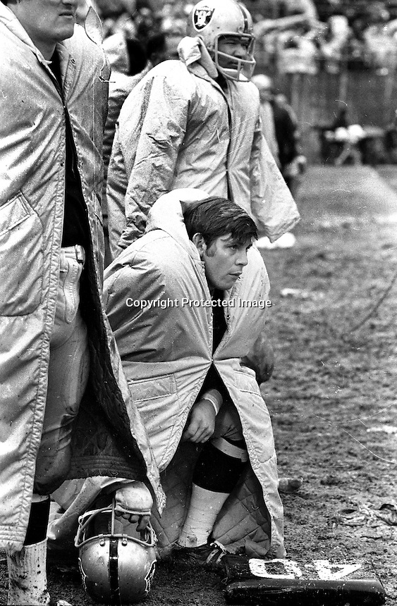 Raider sideline, Marv Hubbard and Charlie Smith..in the rain during Raider-49er game 1970. (photo/Ron Riesterer)
