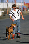 Man Rollerblading  & Dog