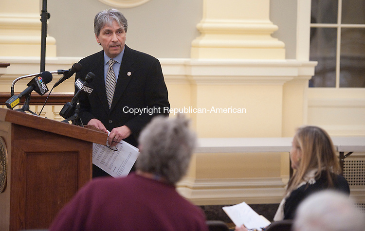 WATERBURY, CT-022714JS01-Michael Caron, interim Director for the Connecticut Public Utilities Regulatory Authority, addresses the crowd during a hearing Thursday at Waterbury City Hall. The hearing was to listed to complaints from the public about alternate energy providers and how customers have seen electric rates skyrocket this winter. Jim Shannon Republican-American
