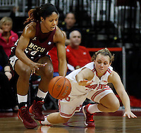 Ohio State's Amy Scullion (25) tries to get the ball away from North Carolina's Khyra Conerly (24) during a women's basketball game between the Ohio State Buckeyes and the North Carolina Central Eagles at Value City Arena on Sunday, December 29, 2013. (Columbus Dispatch photo by Fred Squillante)