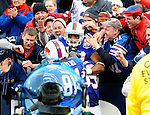 29 November 2009: Buffalo Bills' running back Fred Jackson (22) jumps into the crowd celebrating his touchdown in the 4th quarter against the Miami Dolphins at Ralph Wilson Stadium in Orchard Park, New York. The Bills defeated the Dolphins 31-14. Mandatory Credit: Ed Wolfstein Photo
