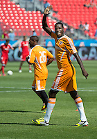 July 28, 2012: Houston Dynamo midfielder Je-Vaughn Watson waves to the fans during the warm-up game between Toronto FC and the Houston Dynamo at BMO Field in Toronto, Ontario Canada..The Houston Dynamo won 2-0.