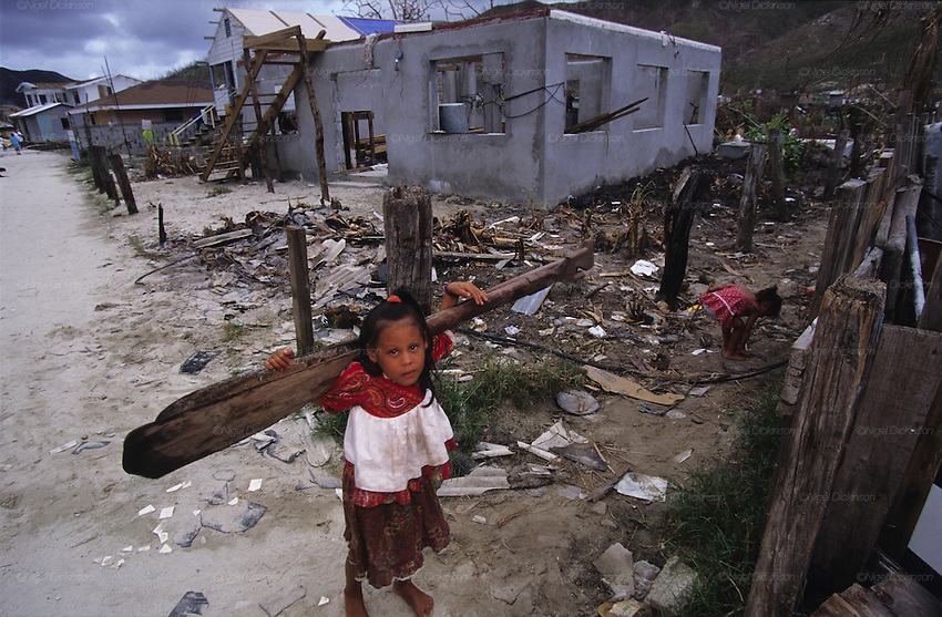 Central America, Honduras, Roatan Islands. Devastation in the aftermath of Hurricane Mitch. High winds and flooding. Humanitarian aid efforts. Refugees. Young girl with oars, paddles. Infrastructure destroyed.