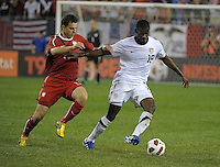 US defender Maurice Edu (19) is pressured by Poland forward Andrzej Niedzielan (17).  The U.S. Men's National Team tied Poland 2-2 at Soldier Field in Chicago, IL on October 9, 2010.