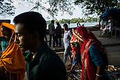 Pedestrians walk past a street vendor in Fort Kochi, Kerala, India.