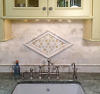 Fiona, a jewel glass water jet mosaic shown in Quartz and Amber with Cloud Nine polished pencil and chair rails, 3&quot;x6&quot; Cloud Nine bricks, and 3 1/2&quot; waterjet Julius border shown in honed Cloud Nine and polished Paperwhite.<br /> -photo courtesy of Fancy Fixtures
