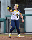 Michigan Wolverines infielder Caitlin Blanchard (44) receives a throw during the season opener against the Florida Gators on February 8, 2014 at the USF Softball Stadium in Tampa, Florida.  Florida defeated Michigan 9-4 in extra innings.  (Copyright Mike Janes Photography)